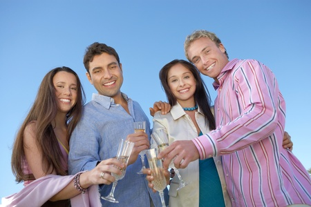 Couples toasting Celebrating with Champagne outdoors low angle view Stock Photo - 8837228