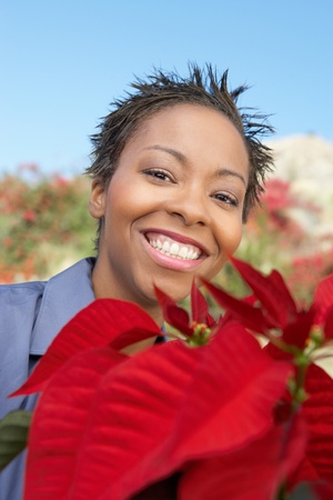 Woman with Poinsettia (close-up) (portrait) Stock Photo - 8822393