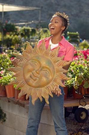 Woman holding garden art at plant nursery Stock Photo - 8837261
