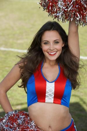 pom poms: Cheerleader in uniform with pom poms