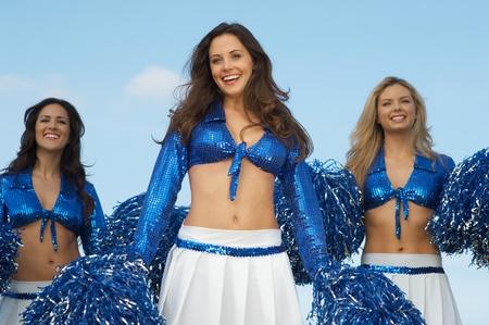 pom poms: Cheerleaders in costume with pom poms