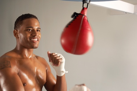 boxing tape: Boxer hitting punching bag head and shoulders