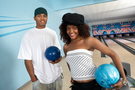 Young couple at bowling alley holding balls portrait Stock Photo - 8837401