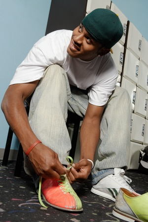 Young man tying bowling shoes portrait Stock Photo - 8837413