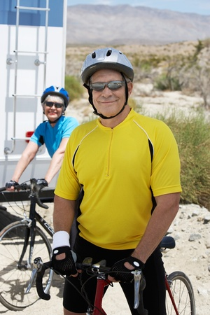 Couple preparing for bicycle ride portrait Stock Photo - 8837421