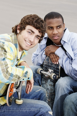 Two young skateboarders sitting outside Stock Photo - 8837430