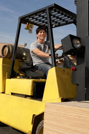 Man operating forklift outside Stock Photo - 8837449