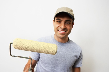 Man holding paint roller portrait Stock Photo - 8837490