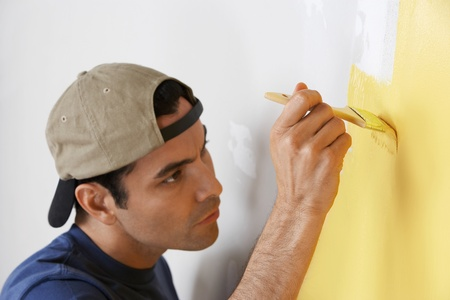 Man carefully painting interior wall close-up Stock Photo - 8822513