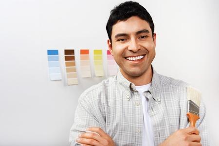 Man holding paintbrush portrait Stock Photo - 8837492