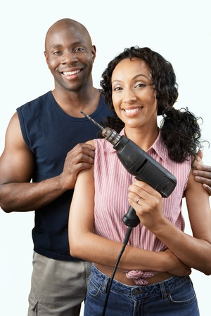 home improvement: Couple with power drill portrait
