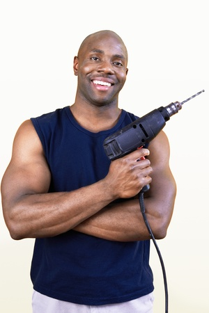 hand drill: Man holding power drill portrait