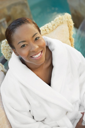 african american spa: Woman relaxing in spa half length elevated view LANG_EVOIMAGES