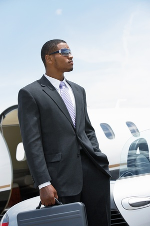 Businessman standing Beside Airplane hand in pocket holding a briefcase Stock Photo - 8822479