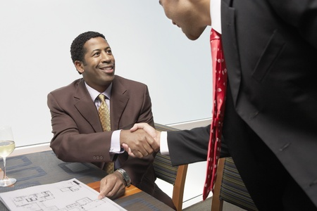 Two Businessmen Shaking Hands In Office Stock Photo - 8822466