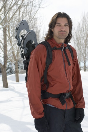 Man carrying snowshoes in snow portrait. Stock Photo - 8844485