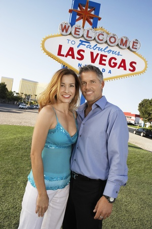 Couple in front of Welcome to Las Vegas sign portrait Stock Photo - 8844488