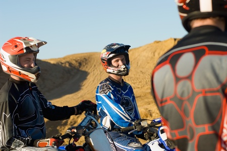 Motocross racers in desert Stock Photo - 8844501