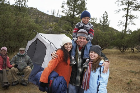 Family with children (7-12) camping (portrait) Stock Photo - 8844519