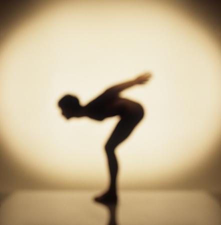 bending down: Silhouette of man bending down