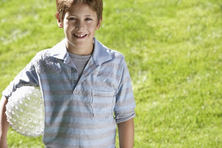 Boy holding ball in park portrait Stock Photo - 8822410