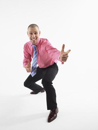 Businessman gesturing in studio Stock Photo - 8844546