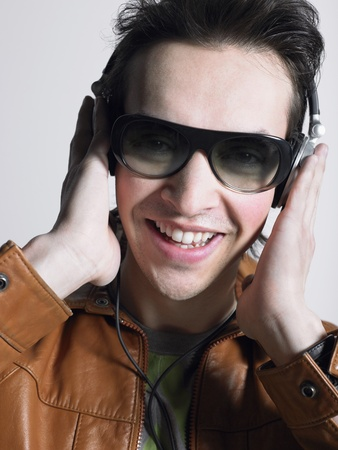 Man wearing headphones and sunglasses head and shoulders Stock Photo - 8844558