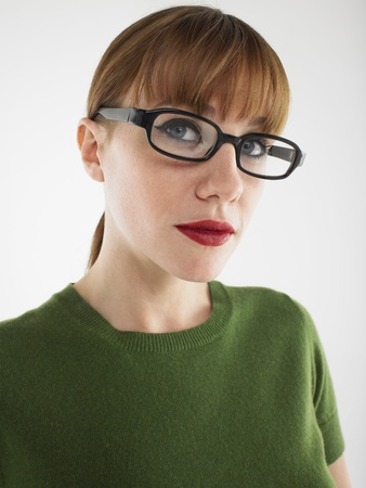 Woman in studio wearing glasses head and shoulders Stock Photo - 8844560