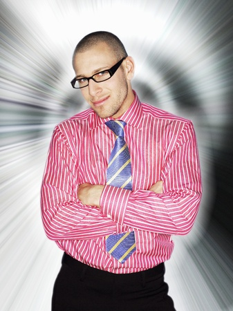 Business man in glasses smiling in front of light effect Stock Photo - 8844579