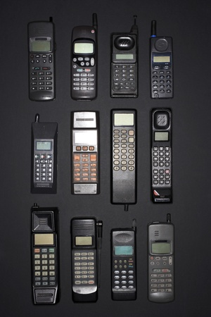 obsolescence: Mobile phones in rows view from above