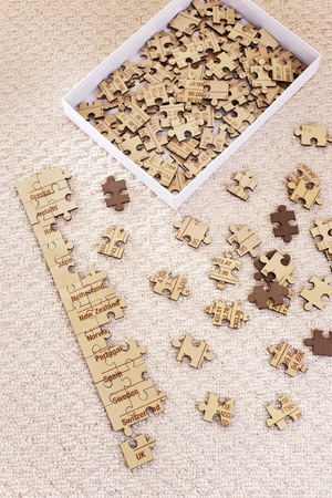 Partly assembled jigsaw puzzle with extra pieces in box elevated view Stock Photo - 8844612