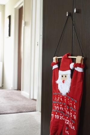 view through door: Santa clause calendar hanging on wardrobe