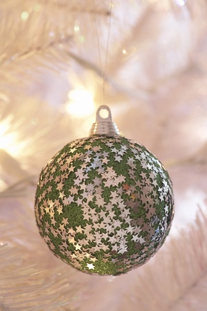 Star covered Christmas bauble hanging on tree close-up Stock Photo - 8844636