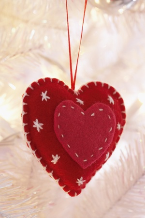 Heart shaped decoration hanging on Christmas tree close-up Stock Photo - 8844637