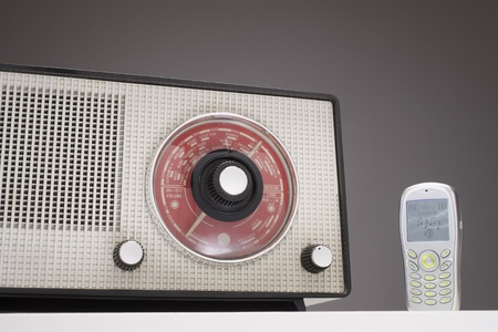 Old Radio and a Cell Phone in studio Stock Photo - 8844737