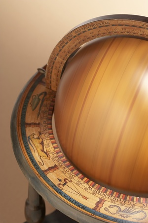 Spinning wooden globe in painted stand cropped in studio Stock Photo - 8844740