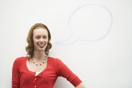 live action: Woman standing in front of graphic on whiteboard