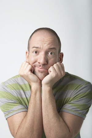 Confused-looking Man with Head in Hands Stock Photo - 8844806