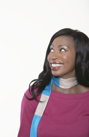 Young smiling Woman wearing scarf looking away Stock Photo - 8844817