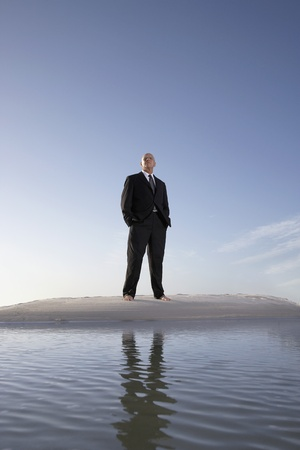 Business man standing on beach portrait low angle view Stock Photo - 8844890