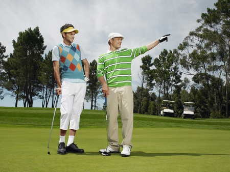 Two male golfers on green Stock Photo - 8844901