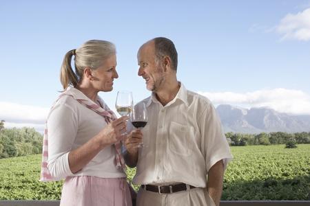 Mature couple holding wine glasses toasting Stock Photo - 8844903