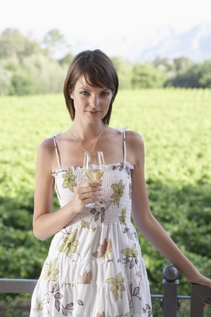 Portrait of young woman holding glass of white wine Stock Photo - 8844905
