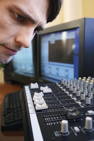 Man looking at mixer close-up. Stock Photo - 8844922