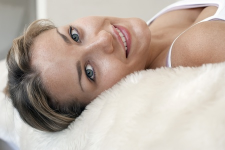 spaghetti strap: Woman lying on bed portrait close-up