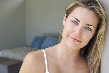 spaghetti strap: Woman standing at bedroom door portrait