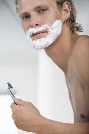 Man shaving face in bathroom portrait Stock Photo - 8844952