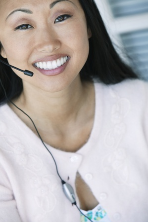 Office Worker Using Telephone Headset Stock Photo - 12513630
