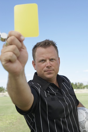 decisionmaking: Soccer Referee Showing Yellow Card LANG_EVOIMAGES