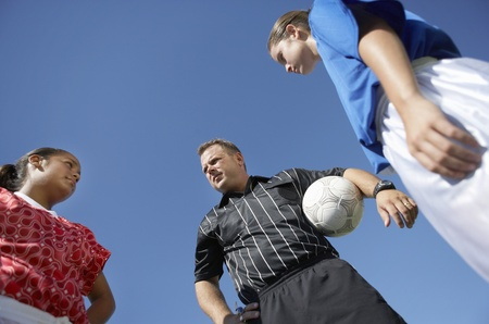 Referee and Soccer Players Stock Photo - 12513638